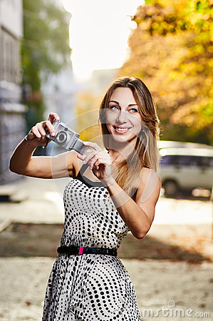 Young smile woman sunlight city portrait