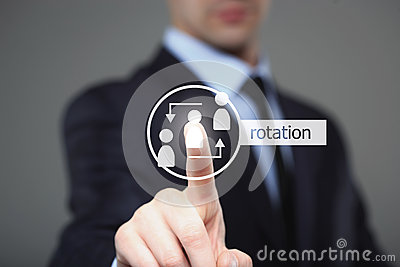 Business, technology and internet concept - businessman pressing Rotation button on virtual screens