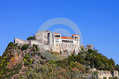 The Leiria Castle built on top of a hill with a view over the gothic Palatial Residence area (Pacos Novos).