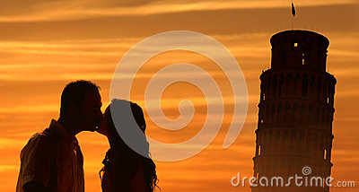 Backlit loving couple honeymoon in Italy