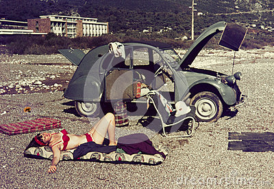 Original vintage colour slide from 1960s, young woman relaxing o
