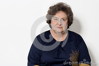 Portrait of beautiful elegant woman in a well-kept older srudii on a white background with makeup and without makeup