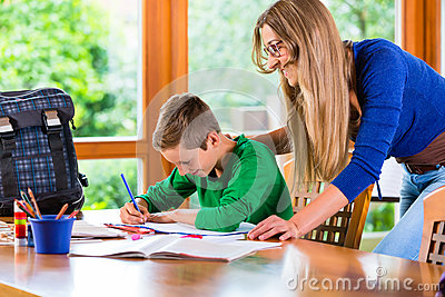Mother helping with school homework assignment