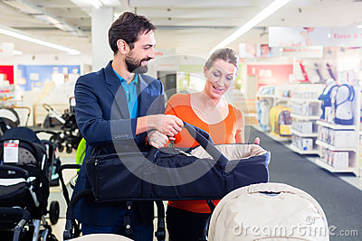 Couple in baby shop buying stroller