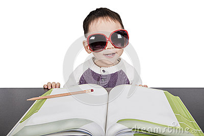 School child boy in glasses studying book