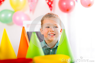 Boy waiting for friends to come to the birthday party