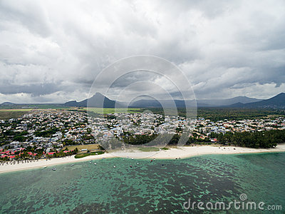 FLIC EN FLAC, MAURITIUS - DECEMBRE 04, 2015: Landscape and Beach in Flic an Flac, Mauritius. Stormy Cloudy Sky and Indian Ocean