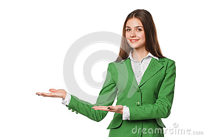 Smiling woman showing open hand palm with copy space for product or text. Business woman in green suit, isolated over white backgr
