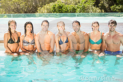 Portrait of friends sitting in swimming pool