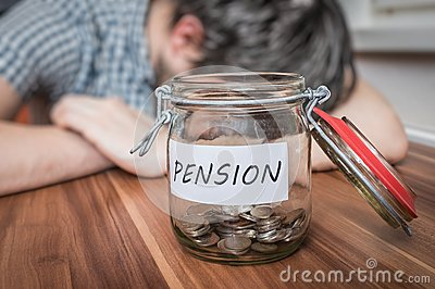 Depressed man lying on table. Pension savings in jar in front