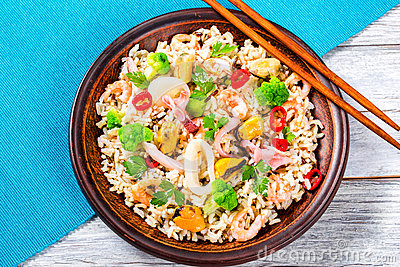 Wild and brown rice with mussels, squid, shrimps, top view