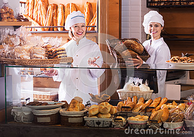 Bakery staff offering bread