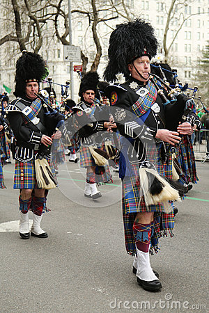 Bagpipers of Nassau Police Pipes and Drums marching at the St. Patrick's Day Parade