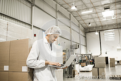 Worker In warehouse for food packaging.