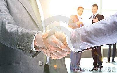 Shaking hands to confirm their partnership
