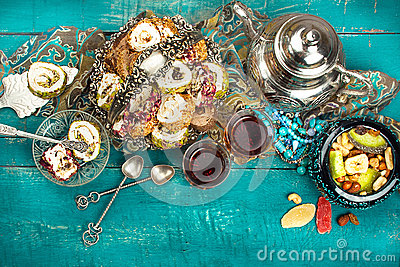 Tea and turkish delight on wooden background