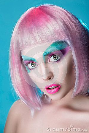 Closeup Beautiful face of puppet girl with face art in pink wig