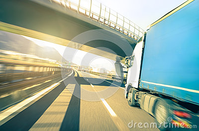 Generic semi truck speeding on highway - Logistic transport concept