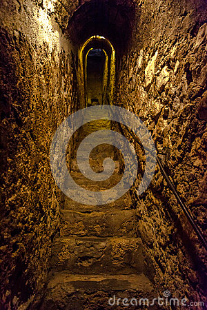 Secret narrow stone stairs tunnel