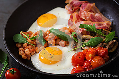 English breakfast - fried egg, beans, tomatoes, mushrooms, bacon