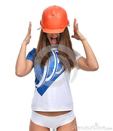 Young beautiful woman yelling screaming in orange construction h