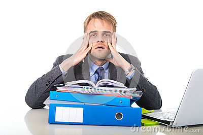 Young overworked and overwhelmed businessman in stress leaning on office folder exhausted and depressed