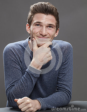 Portrait of smiling young male student looking friendly