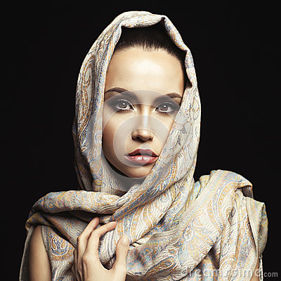 Beautiful lady wrapped in a orient shawl