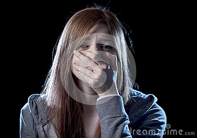 Teenager girl in stress and pain suffering depression sad and scared in fear face expression