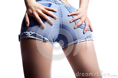 woman in fashion blue jeans shorts. Perfect hot booty and erotic curves hips. Good body shapes whithout cellulite