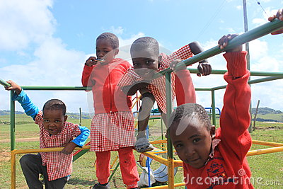 Group of African children playing outside in a playground, Swaziland, southern Africa
