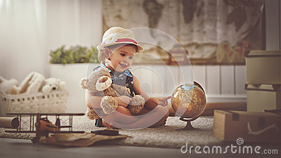 Concept travel. child girl at home dreaming of travel and tourism