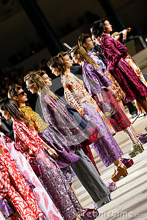 Models pose on the runway during the Dries Van Noten show