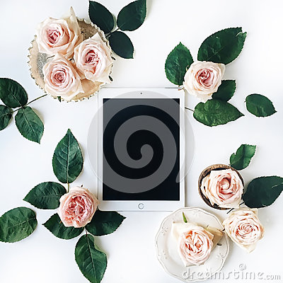 Tablet, vintage golden tray, retro plate and pink rose flower with green leaves on white background