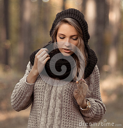Lovely,pretty,sensual,cute girl in sweater,scarf in autumn