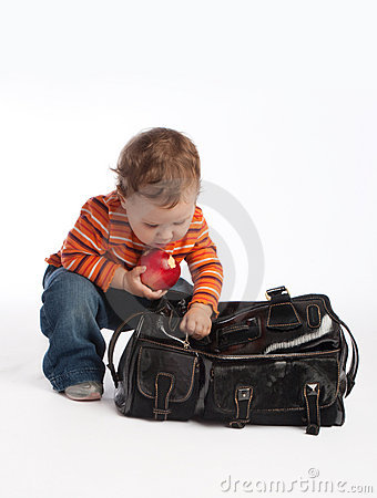 Kid with apple unzips female bag