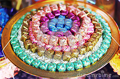 Coins in colorful ribbin in a gold bowl for Newly ordained Buddhist monks