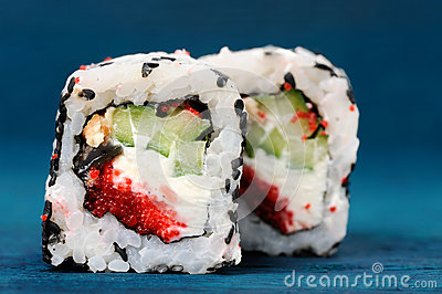 Pair of square sushi rolls with vegs, cream cheese and red roe o