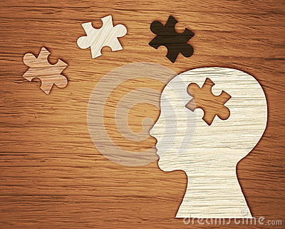 Mental health symbol. Human head silhouette with a puzzle