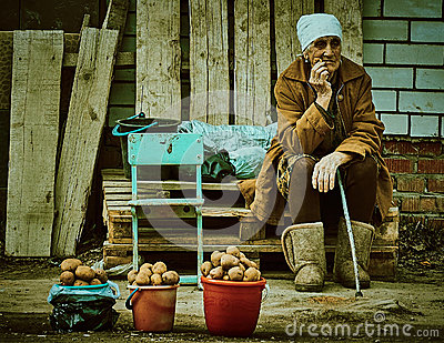 Old Russian woman selling potatoes Kaluga region.