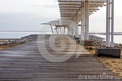 Wooden pier at morning at Dead Sea
