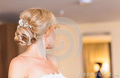 Beautiful stylish bride getting ready in the room