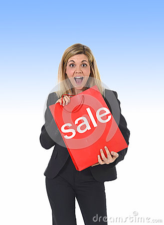 Young beautiful woman holding sale red shopping bag