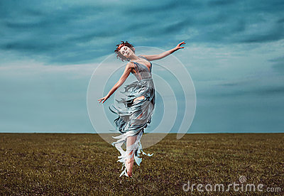 Girl muse, dancing in a field