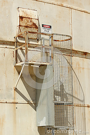 Red, black and white Danger, Confined Space warning sign on the exterior of a silo
