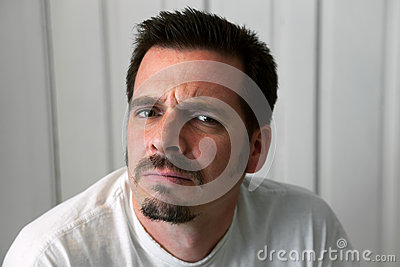 Scowling Man With Goatee