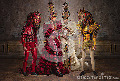 Chess queens with men in horse masks