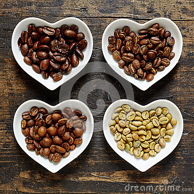 Four types of coffee beans in heart shaped bowls