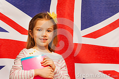 Photo of girl with textbooks against English flag