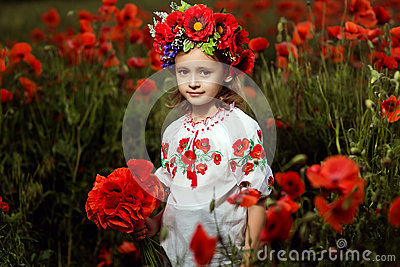 Little girl in poppy field